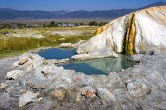 Travertine Hot Springs. Lower Pools. On the background, Bridgeport. California, USA royalty free stock image