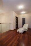 Travertine house - armchair on a corridor Royalty Free Stock Photo