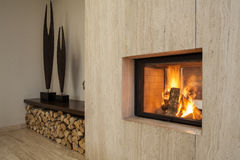 Travertine house: fireplace Royalty Free Stock Photo