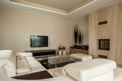 Travertine house: Fireplace in living room Stock Photography