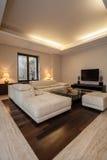 Travertine house: Illuminated interior Royalty Free Stock Photography