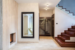 Travertine house: mirror and stairs Royalty Free Stock Images