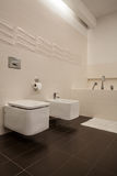 Travertine house - toilet and bidet Royalty Free Stock Image