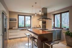 Travertine house - view of a kitchen. Travertine house - view of a bright, modern kitchen royalty free stock image