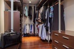Travertine house - walk-in wardrobe Stock Photography