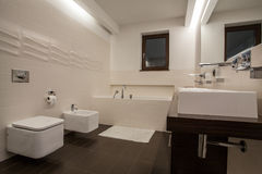 Travertine house - well-designed bathroom. In bright color royalty free stock image