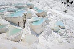 Travertine pools at Pamukkale. Blue cyan water travertine pools at ancient Hierapolis, now Pamukkale, Turkey Royalty Free Stock Photo