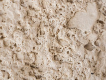 Travertine stone wall texture Stock Images