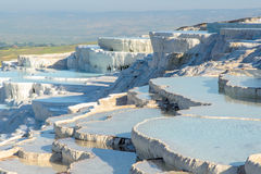 Travertine terrace, Pamukkale. The enchanting pools of Pamukkale in Turkey. Pamukkale contains hot springs and travertines, terraces of carbonate minerals left Royalty Free Stock Image