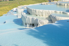 Travertine terrace, Pamukkale. The enchanting pools of Pamukkale in Turkey. Pamukkale contains hot springs and travertines, terraces of carbonate minerals left Royalty Free Stock Photos