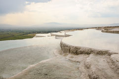 Travertine terraces filled with water Stock Image