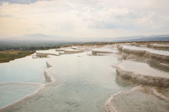 Travertine terraces filled with water Royalty Free Stock Photography