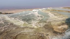 Travertine terraces at Pamukkale, Turkey. 4k. Travertine terraces at Pamukkale are one of the most spectacular natural wonders with various mineral springs in a stock footage
