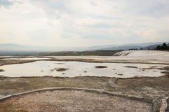 Travertine terraces. Travertine teraces some empty and some filled with water in Pamukkale, Turkey Royalty Free Stock Image