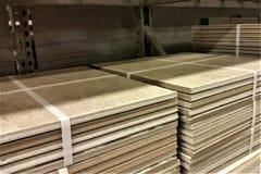 Bundles of Floor Tile on Warehouse Shelf. Travertine tile in bundles on DIY warehouse shelf Stock Photo
