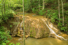 Travertine Water Formation. This travertine formation is formed by a process of rapid precipitation of calcium carbonate from the limestone caves which are Royalty Free Stock Images