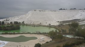 Travertines with blue water in pamukkale, turkey.  stock footage