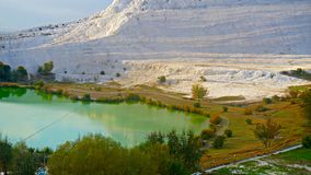 Travertines with blue water in pamukkale, turkey.  Stock Photography