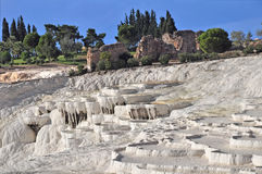 Travertines at Pamakkale, Turkey. Hot springs bubbling from underground have created this wonderland of white calcium deposits. Known as the White Castle, the Royalty Free Stock Image