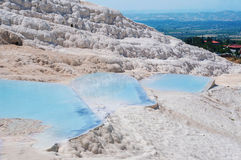 Travertines in Pamukkale. Blue travertines or mineral pools in Pamukkale, Turkey Stock Photography