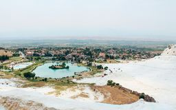 Travertines of Pamukkale and town in Turkey. Travertines of Pamukkale and old town in Turkey Royalty Free Stock Image
