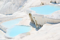 Travertines in Pamukkale, Turkey. Carbonate travertines with blue water - unique nature wonder in Pamukkale, Turkey Royalty Free Stock Photos
