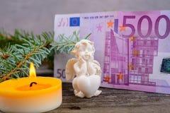 Travesaño de la Navidad con el dinero Foto de archivo libre de regalías