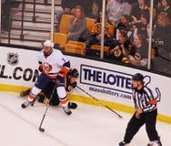Travis Hamonic New York Islanders. New York Islanders defenseman Travis Hamonic pins Boston Bruins forward Tyler Seguin (19) against the boards stock images