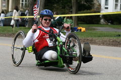 Travis Hill races his handcycle up the Heartbreak. BOSTON - APRIL 20 : Travis Hill races his handcycle up the Heartbreak Hill during the Boston Marathon April 20 Royalty Free Stock Photos