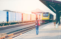 Travler women walking alone Carrying luggage and waits train Royalty Free Stock Images