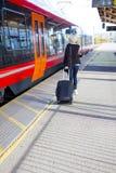 Travling woman at a outdoor train terminal Royalty Free Stock Image