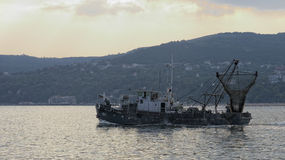 Trawl boat in Balchik. A trawl boat and fishers in Balchik, Bulgaria royalty free stock photo
