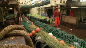 Trawl, which is lowered into the sea. View from the deck stock video