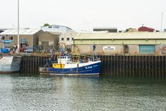 Trawler berthed in the busy Kilkeel Harbour in County Down stock photo