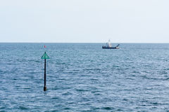 Trawler boat heading out to sea Stock Photography