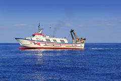 Trawler boat working in mediterranean offshore Stock Photos
