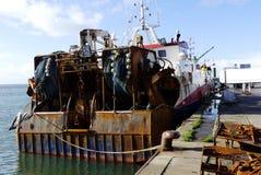 Trawler fishing boat docked at the fishing harbor Royalty Free Stock Images