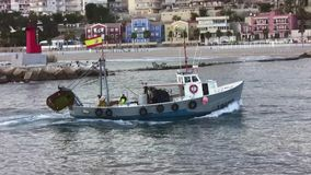 Trawler fishing boat. Entering in the port of Villajoyosa in Spain stock video footage