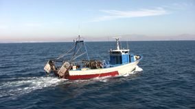 "Trawler fishing boat. The trawler fishing boat ""Margarita La Escolana"" works in open waters in Alicante coast stock footage"