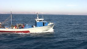 "Trawler fishing boat. The trawler fishing boat ""Margarita La Escolana"" works in open waters in Alicante coast stock video"