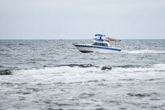 Trawler fishing boat sailing in open waters Stock Images