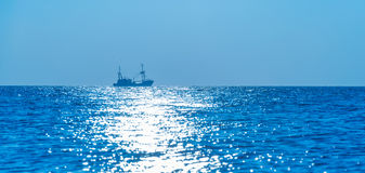 Trawler fishing at sea at sunset. In autumn stock images