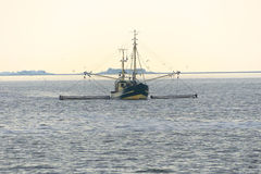 Trawler in front of a North Frisian Island Stock Image