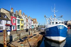 Trawler and quayside buildings, Weymouth. Royalty Free Stock Photos