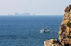 Trawler in the Sea of Peniche. Trawler at sea of Peniche with the Berlengas island in the horizon line stock photography