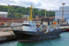 Trawler ship in harbor Stock Photo