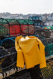 Trawlerman's protective oilskin smock, and lobster pots, Scarborough Stock Photos