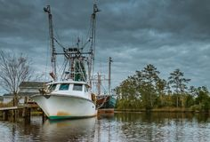 Trawlers Berthed in Overcast Weather Stock Photos