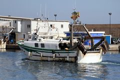 Trawlers fishing boats going to dock after work. Stock Photography