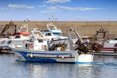 Trawlers fishing boats going to dock after work. Royalty Free Stock Images